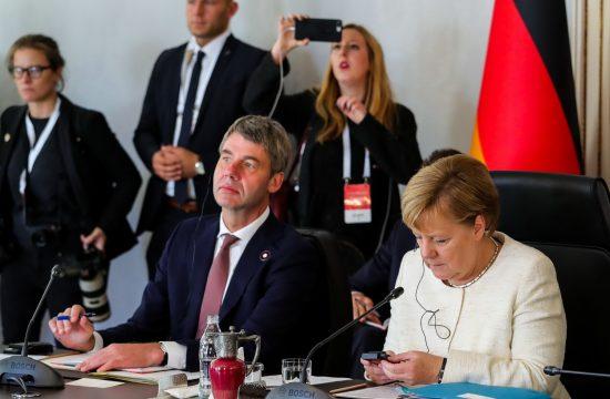 Jan Heker i Angela Merkel